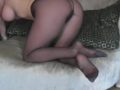 Visious nympho stretches legs in tights to boast of her twat
